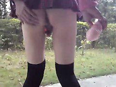 Teen japanese CD masturbates outside